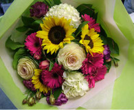 Seasonal mixed bouquet including geberas, lizzianthus, sunflowers