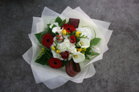 Geberas, Freesias, flax, roses and other seasonal flowers and foliage