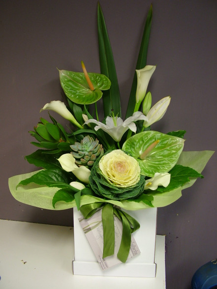 Beautiful Classic arrangement of Green and White shades.
