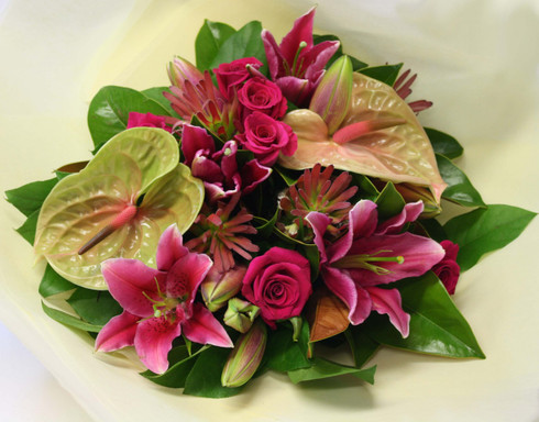 Antheriums, Roses and oriental lilies with seasonal foliage.