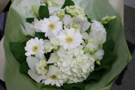 Beautiful white bouquet. So very pretty with white flowers and green foliage.