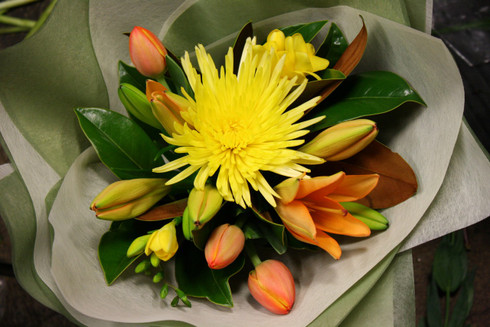 Bright Florist choice assortement of Yellow and Oranges in a beautiful Bouquet