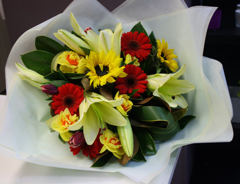 Florist Choice Bright arrangment of Reds and Yellows,