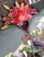 Large martini glass filled with stones and oriental lilies  Colours in White and Pink