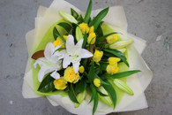 White Lilies and Yellow roses, Fresh and beautiful with the lovely scent of the oriental lilies. This will shake up anyones day !  Made with assorted greenery.