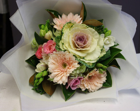 Pale pinks, whites and creams, Beautiful soft tones this bouquet is mildly scented including freesias, gerberas, kale and roses.