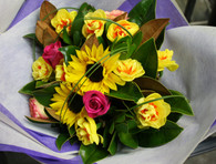 Bright Bouquet of Roses, Doubles daffs and sunflowers. Funky loops of grass over the flowers for a modern twist