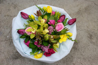 A wild garden posy made with assorted seasonal blooms and foliages.