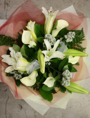 Lilies and callas with native foliages.
