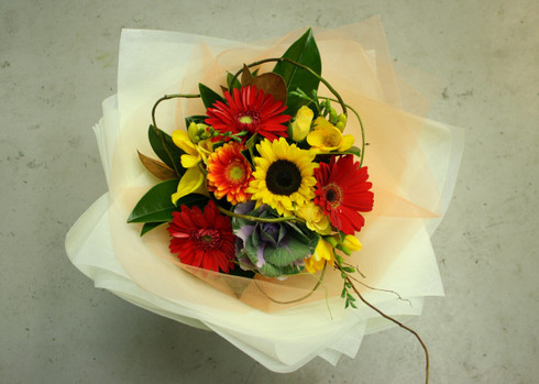 Vibrant colours to warm up anyones day ! includes Happy sunflowers and Gerberas, roses, fressias, Callas, and seasonal blooms