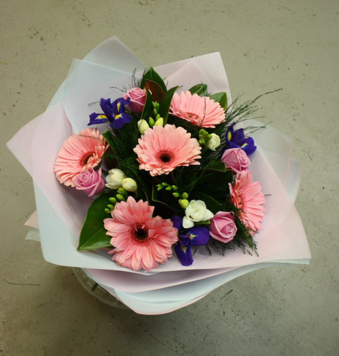 Hand tied pale pink, blue and white bouquet of Roses, Freesias, Gerberas and seasonal blooms and foliage.