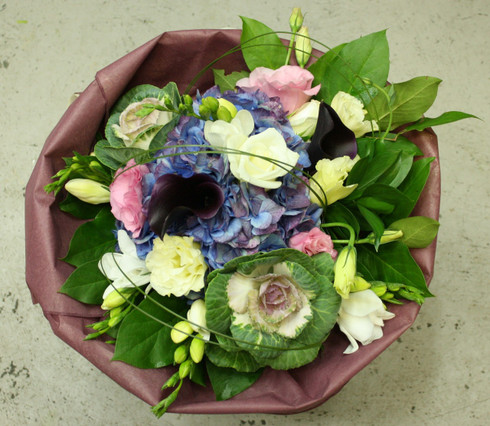 Seasonal bouquet of Pinks, whites, purples and blues incs freesias, callas, hydrangeas and lisianths.