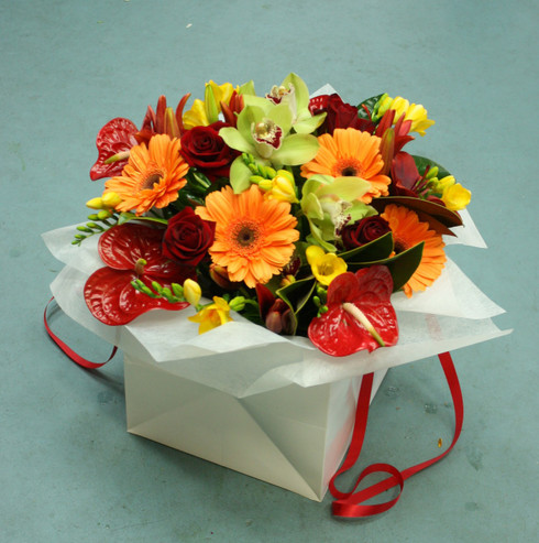 Seasonal carry bag arrangement of rich reds, oranges, yellows and greens.