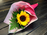 Single flower with assorted greenery. You may choose from a Sunflower,Gerbera and lily or a florist choice   Flower is subject to availability