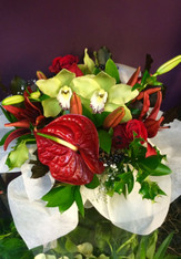 Christmas themed arrangement in reds and greens.