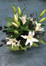 Box arrangement of White lilies and contrasting foliage.