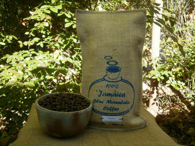 Peaberry 100% JBM coffee one-pounder with sample Peaberry JBM beans displayed.
