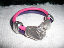 Hot pink and purple leather double strand bracelet. Antique silver accents and serpent head clasp. 5.5 inches