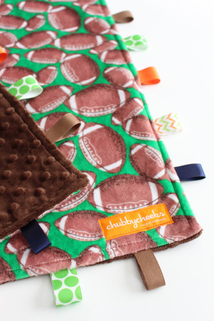 Football large tag blanket with brown minky back.