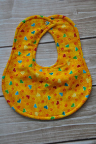 Hearts on yellow classic baby bib