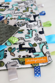 Dinosaurs tag blanket (large) with green minky back.