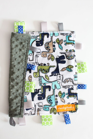 Dinosaurs tag blanket (small) with green minky back.