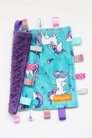 Small Unicorns tag blanket with purple minky back.