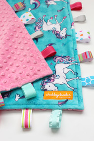 Large Unicorns tag blanket with pink minky back.