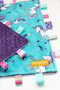 Large Unicorns tag blanket with purple minky back.