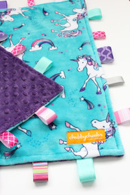 Large Unicorns tag blanket with purple minky back.