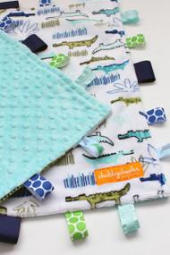 Large Alligators tag blanket with light teal minky back.