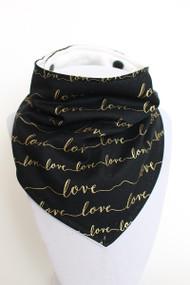 Love - Gold on Black bandana bib with organic bamboo back.
