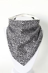 Itsy Bitsy Alphabet Black bandana bib with organic bamboo back.