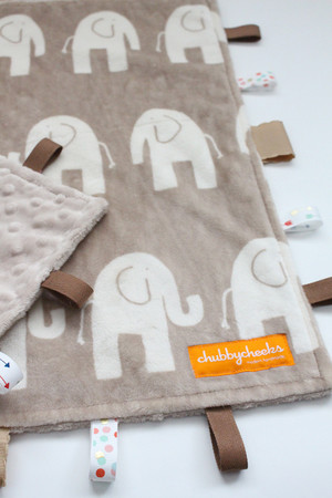 Tan Elephant tag blanket with tan back.
