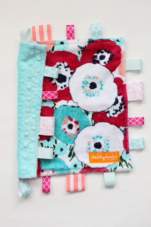 Blossom tag blanket with teal minky back.
