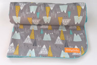 Mountains minky back blanket with teal minky back.