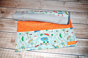 "Quilted blanket with grey minky back. Crib size - approx. 37""w x 40""."