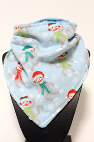 Winter sock monkey bandana bib with blue minky back.