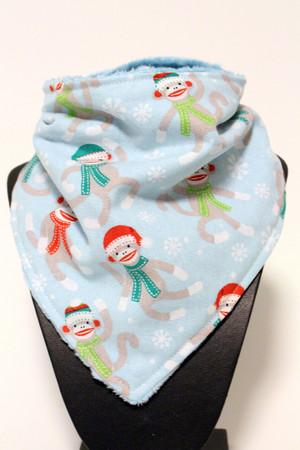 Winter sock monkey bandana bib with blue minky back.