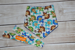Little monkey gift set including a bandana bib and matching toy strap