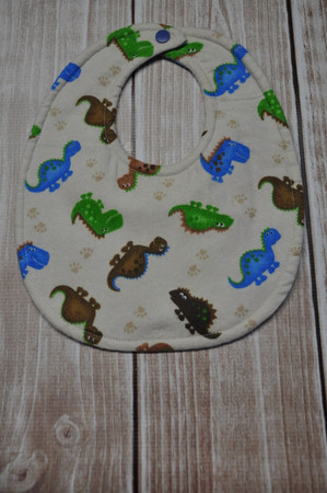 Small classic bib - dino on tan