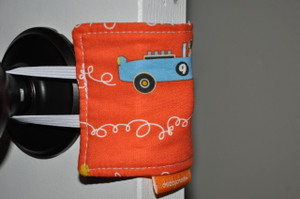 "It's all in the name! It's a door silencer. Placed over the handles of a door knob, the padded fabric blocks the latch from making noise when opening and closing the door. Great for little ones who hear you leaving after tucking them in. Also good for frequently used doors (bathrooms, children's rooms, etc). Helps assist in those ""Shhhh!"" moments."
