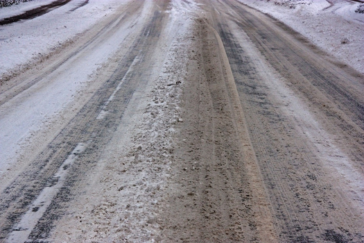 Icy gritted winter roads