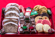 Gourmet Basket of Delights!   Sure to please any office with treats for the entire day!  Start off with our freshly baked banana bread, a full pound of chocolate pecan fudge, three designed petite cookies, one dozen of our freshly baked gourmet cookies and six Christmas designed cake balls to finish.