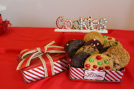 One dozen gourmet cookies in Christmas tin.  Enjoy delicious and individually wrapped gourmet cookies including chocolate chip, oatmeal raisin, double chocolate, red velvet, rainbow, and snicker doodle cookies.