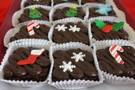 One dozen Christmas Frosted Brownies.  Our signature chocolate iced brownie with a great Christmas decoration to top it off.