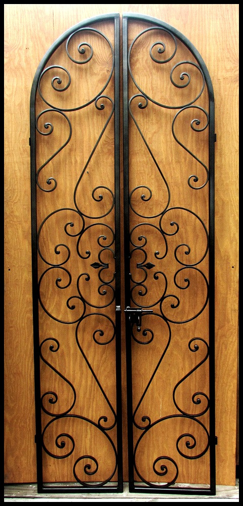Forged scroll iron wine cellar double door leos iron for Basement double door