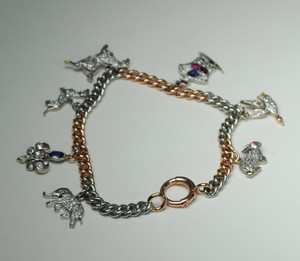 Edwardian/Art Deco Platinum and Diamond Charm Bracelet