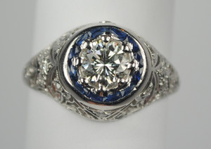 Art Deco .73 Carat Diamond Engagement Ring with Halo of French-cut Sapphires