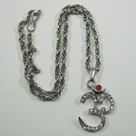 AUM Symbol Necklace with Red Crystal